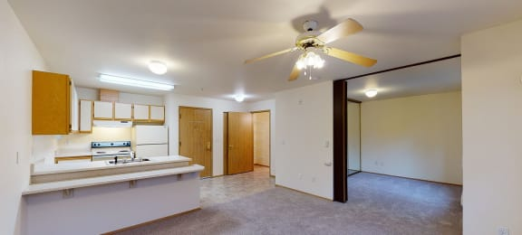 Kitchen and living room at Woodrose Apartments in Bellingham WA