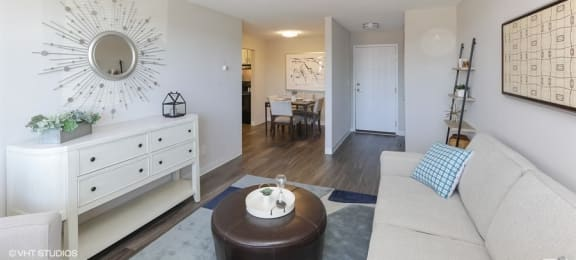 Spacious living room with luxe flooring at Equinox Apartments