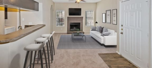 Model living room with kitchen and bar seating