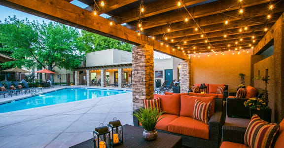 Pool, pool patio & community patio at tierra pointe apartments in Albuquerque, nm