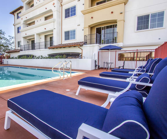 Swimming Pool with Lounge Chairs at Le Blanc Apartment Homes, California, 91304
