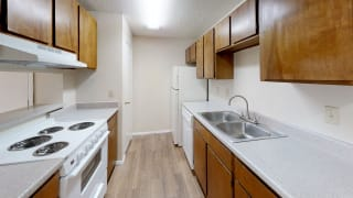 View of Kitchen in Maple floor plan at Arbors of Cleburne Apartments