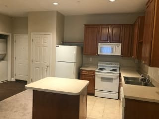 Modern Kitchen With Stainless Steel Appliances And Double Door Refrigerators at Renaissance at the Power Building, Ohio, 45202