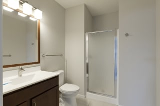 Upgraded Bath Vanity with Wood Framed Mirror at Waterstone Place, Minnetonka, MN, 55305