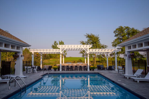 Outdoor Swimming Pool with Expansive Sundeck and Pergola