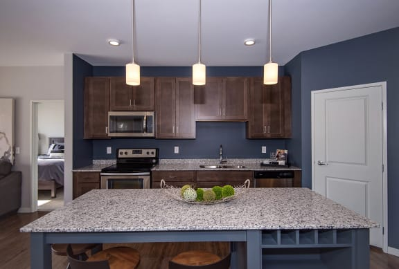 Pendant Lighting Over the Large Granite Kitchen Island