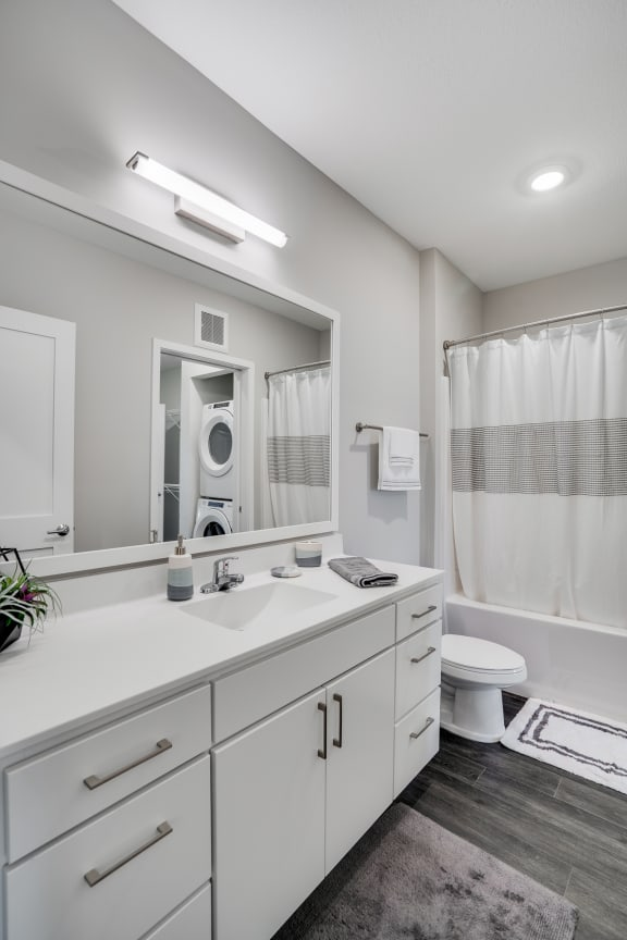 Spacious Bathroom with White Cabinetry