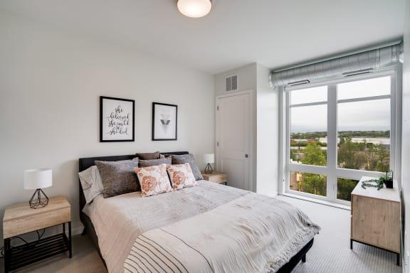 Large Floor to Ceiling Windows in Bedroom