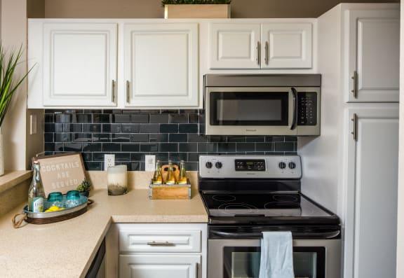 Modern Kitchens with Light Stone Countertops and Subway Tile Backsplash