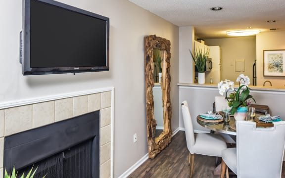 Dining Room Area with Wood-Style Flooring and Fireplace