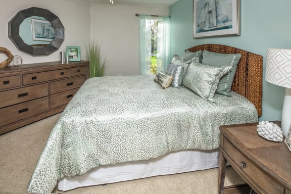 Spacious Bedroom with Plush Carpet and Large Window