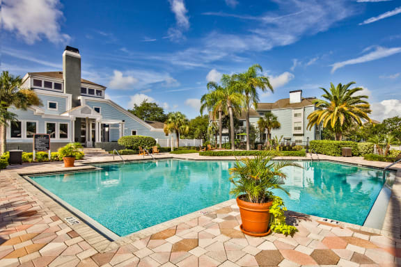 Spacious Outdoor Pool with Expansive Sundeck and Manicured Landscaping