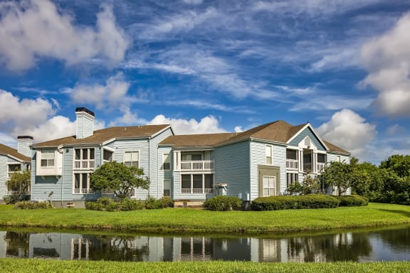 Exterior Patios and Balconies Overlooking a Pond at Isles of Gateway