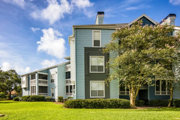 Lush Landscaping and Grass in Front Of Apartment Homes at Isles of Gateway