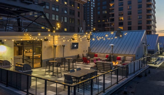 Rooftop Patio with fire pit and big screen TV