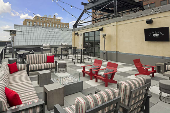 Rooftop Patio with Fire Pit Under String Lights