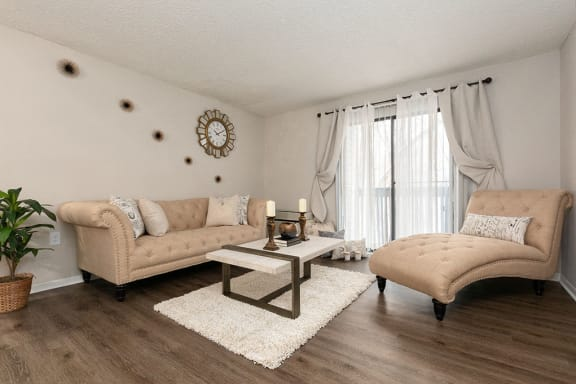 Living Room with Hardwood Style Flooring and Sliding Patio Door with Built-In Blinds