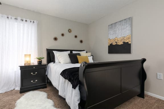 Bedroom with Plush Carpet and Large Window with Built-In Blinds
