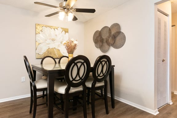 Spacious Dining Room with Ceiling Fan and Light and Hardwood Style Flooring