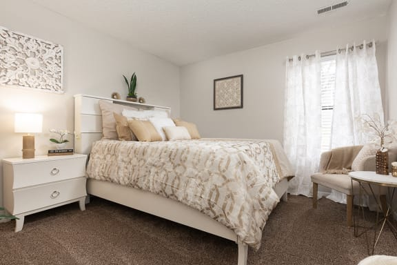 Bedroom with Plush Carpeting and Large Window