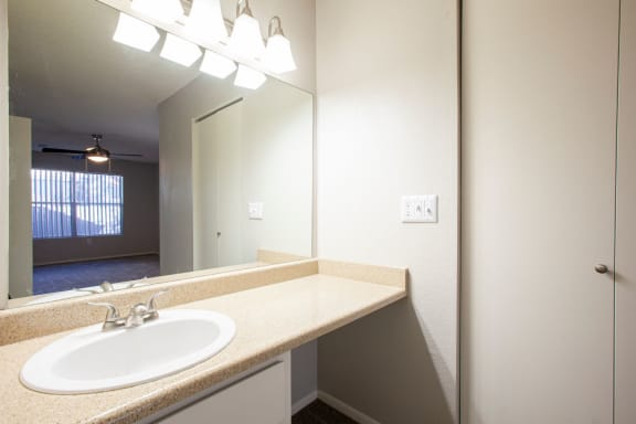 Bathroom vanity at Orange Tree Village Apartments in Tucson AZ
