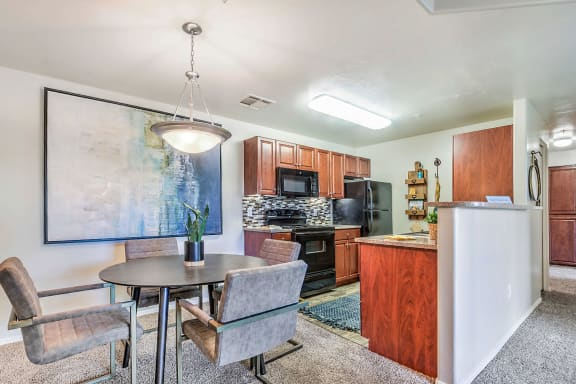 Dining area and kitchen at Equestrian Apartments in Tucson AZ March 2020