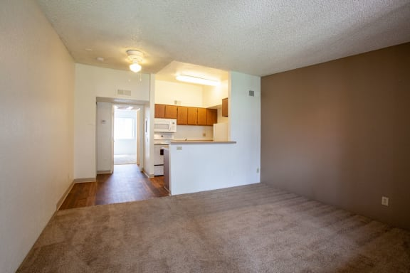 Living room and dining area at Casa Bella Apartments in Tucson AZ 4-2020