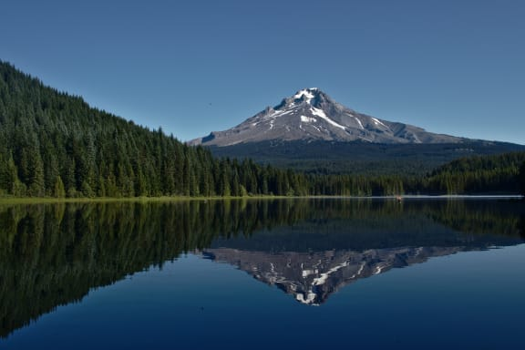 Photo of a lake near Mount Hood with Mount Hood in the background and reflected in the lake.