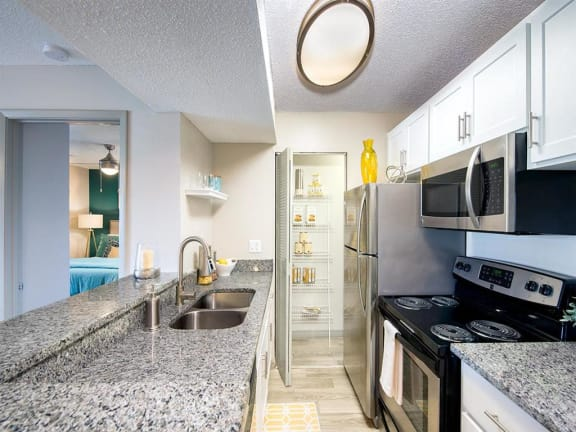 model unit kitchen with granite counter tops