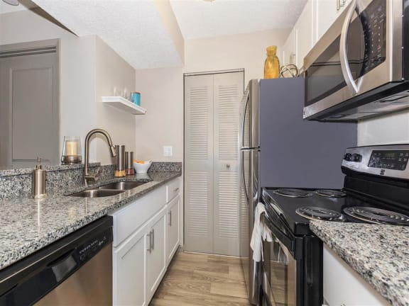 stainless steel appliances and granite counter tops in kitchen