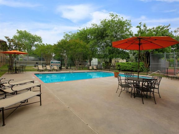 the granite at tuscany hills san antonio apartments pool lounge chairs and tables