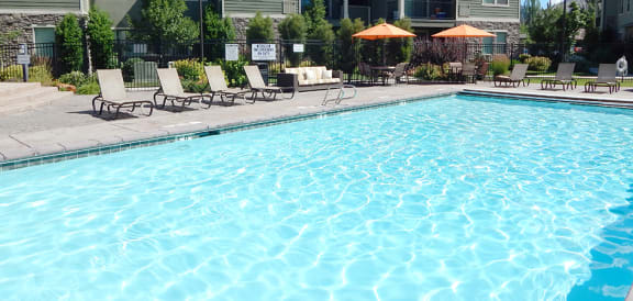 Swimming Pool With Relaxing Sundecks at Falls at Riverwoods Apartments & Townhomes, Logan, 84321
