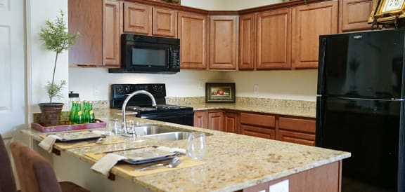 Eat-In Kitchen Table With Sink at Falls at Riverwoods Apartments & Townhomes, Logan, UT
