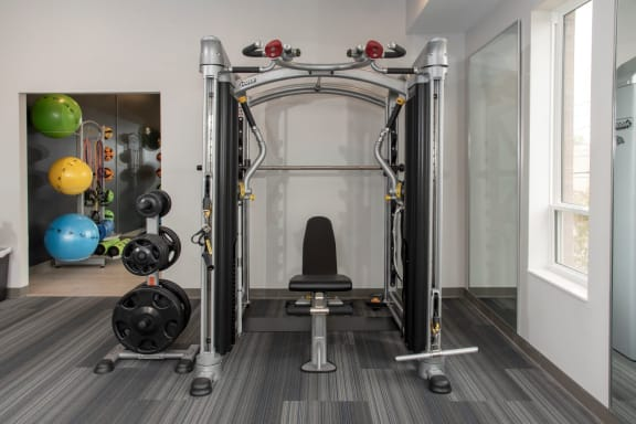 fitness room with weights and yoga room