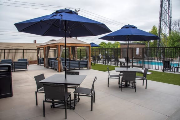 UPII outdoor patio with seating, firepit and cabanas