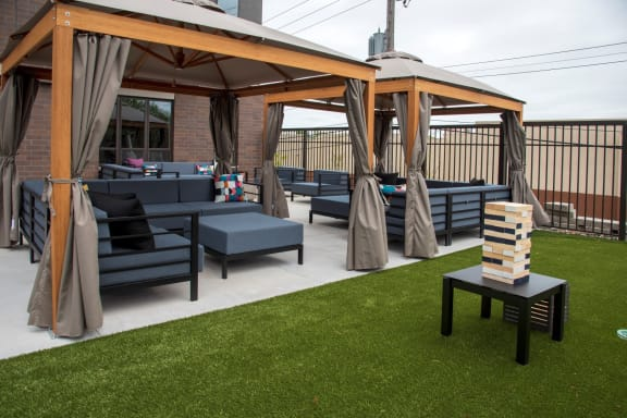 UPII outdoor lounge seating with oversized outdoor jenga and cabanas