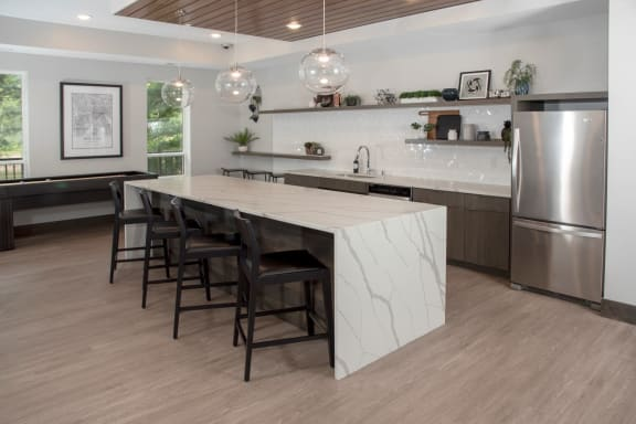 Community kitchen with bar seating and shuffleboard table