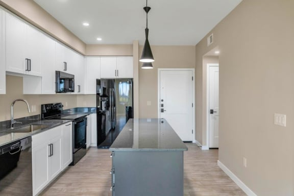 Gourmet Kitchen Islands at The Premiere at Eastmark Apartments, P.B. BELL, Mesa, AZ
