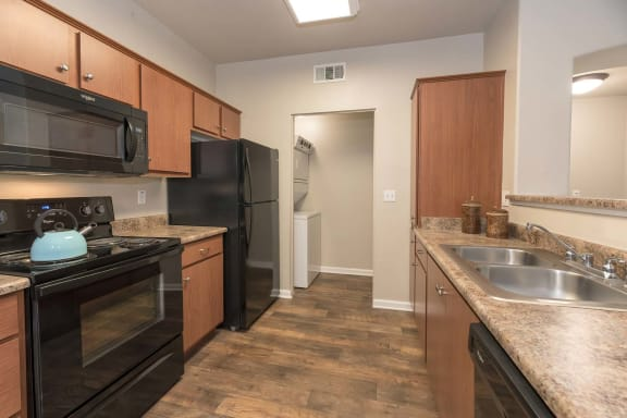 Wood-style Plank Flooring In Kitchen And Living Areas at Sterling Village Apartment Homes, Vallejo