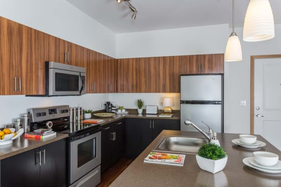 Fully Furnished Kitchen With Stainless Steel Appliances at Tivalli Apartments, Lynnwood, WA