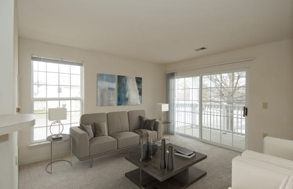 Living Room Rendering with gray couch and coffee table