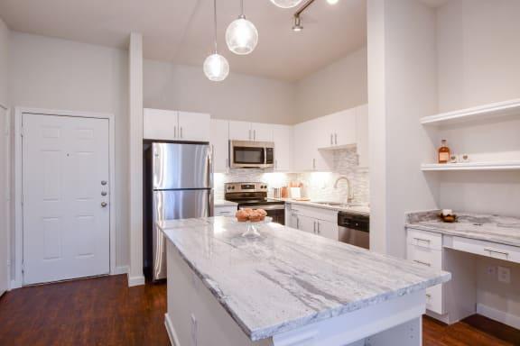 Stainless steel refrigerators, stoves, dishwashers