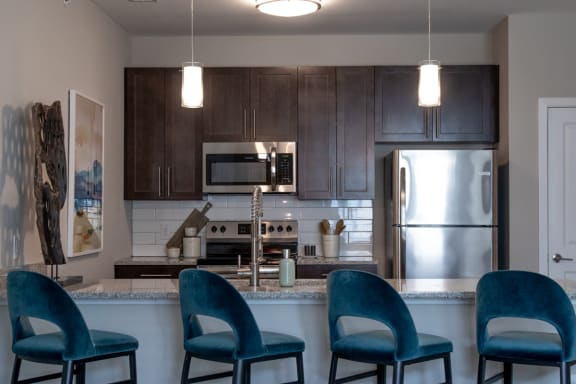 Fitted Kitchen With Island Dining at The Century at Purdue Research Park, Indiana, 47906