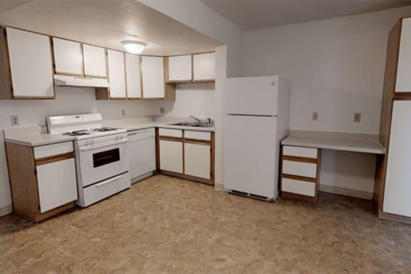 Kitchen with Dishwasher at Arbor Pointe Townhomes in Battle Creek, MI