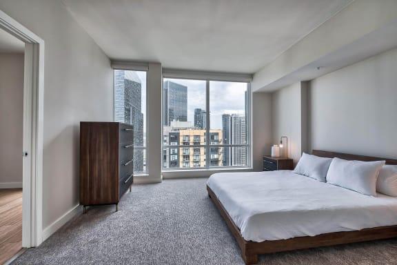 Master bedroom with large windows at The Martin, Seattle, Washington