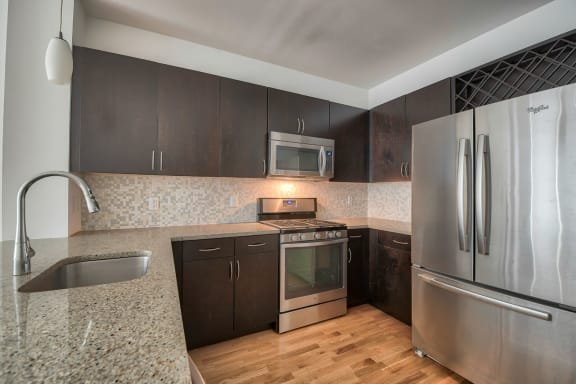 Granite Counters and Mosaic Tiled Backsplashes at Warren at York by Windsor, Jersey City