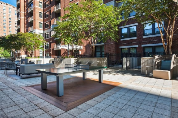 New Courtyard Lounge with Fire Pit, BBQ Grills, and Outdoor Games at Halstead Tower by Windsor, Alexandria, VA