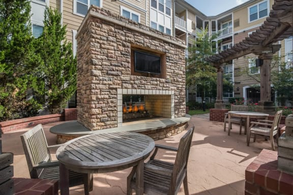 Relaxing Outdoor Lounge Area with Fireplace  at Windsor at Contee Crossing, Maryland, 20707