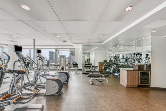 Fully Equipped Fitness Center with Floor-To-Ceiling Windows at The Bravern, Bellevue, WA