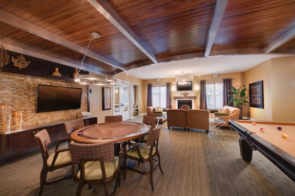 TV Screens and Fireplace In Clubroom at The Ridgewood by Windsor, Fairfax, Virginia